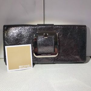 Michael Kors silver and metallic detail clutch.